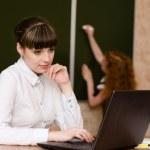 Teacher using a laptop computer at school — Stock Photo #31882171