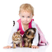 Little girl with a puppy and a kitten. isolated on white background — Stockfoto