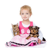 Little girl hugging a kitten and a puppy. isolated on white background — Stock Photo