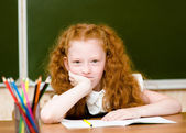 Portrait of lovely schoolgirl looking at camera — Stock Photo
