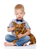 Child hugging a dog. isolated on white background — Stock Photo