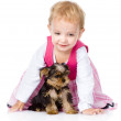 Little girl playing and crawling with a puppy. — Stock Photo