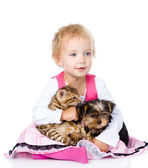 Little girl hugging a kitten and a puppy. — Stock Photo