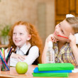 Little girls sitting and studying at school class — Stock Photo