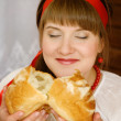 Woman smelling bread — Stock Photo