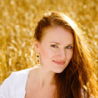 Beautiful woman  on wheat field — Stock Photo