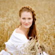 Young beautiful woman in field — Stok fotoğraf