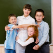 Children hugging their teacher — Stock Photo