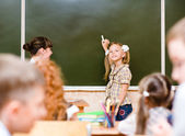 Schoolgirl answers questions of teachers — Stock Photo