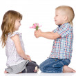 The little boy gives to the girl a flower. — Stock Photo