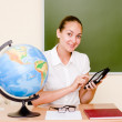 Teacher holding a tablet computer at classroom — Stock Photo