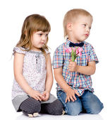 Resentful boy gives to the girl a flower. — Stock Photo