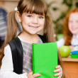 Portrait of pretty preschool girl with backpack — Stock Photo