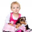 Little girl hugging a puppy.   — Stock Photo