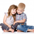Smiling brother and little sister hugging.  — Stock Photo