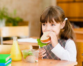 Portrait schoolgirl while having lunch during — Stock Photo