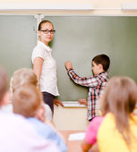 Boy answers questions of teachers — Stockfoto