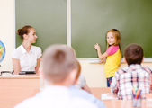Girl answers questions of teachers — Stock Photo