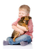 Little boy hugging a dog. — Stock Photo