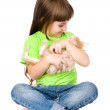 Little girl hugging kitten. Isolated on white background — Stock Photo #37383367