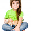 Little girl stroking a kitten. Isolated on white background — Stock Photo