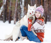 Beautiful girl in winter forest with dog — Foto Stock