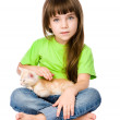 Little girl stroking kitten. — Stockfoto #37695323