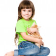 Little girl hugging kitten. — Stock Photo