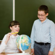 Teacher with Globe — Stock Photo