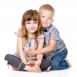 Brother hugging little sister . — Stock Photo #39249025