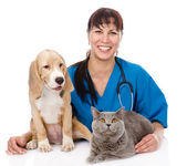Laughing veterinarian hugging cat and dog. — Stock Photo