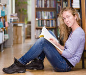 Happy female student in library — Stock Photo