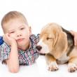 Sad boy hugging beagle puppy — Stock Photo