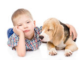 Sad boy hugging beagle puppy — Stock Photo