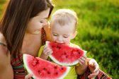 Mother and son eat watermelon — Stock Photo