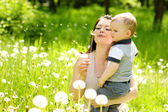 Mother and boy blowing dandelion — Foto Stock