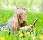 Beautiful girl  using tablet computer — Stock Photo