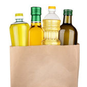 Bag of oil bottles — Stock Photo