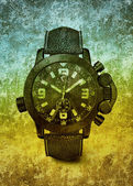Grunge watch on the colored background with many scratch — Stock Photo