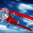 Stock Photo: Biplane on the Sky