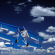 Blue Biplane on the Sky - Stock Photo