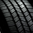 Car Tire on Black — Stock Photo