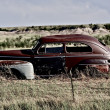 Clunker on Prairie - Stock Photo