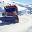 Foto Stock: Snowplow Clearing Road