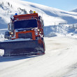 Foto de Stock  : Snowplow Clearing Road