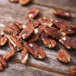 Stock Photo: Pecans on Wood