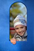 Girl in playhouse — Stock Photo