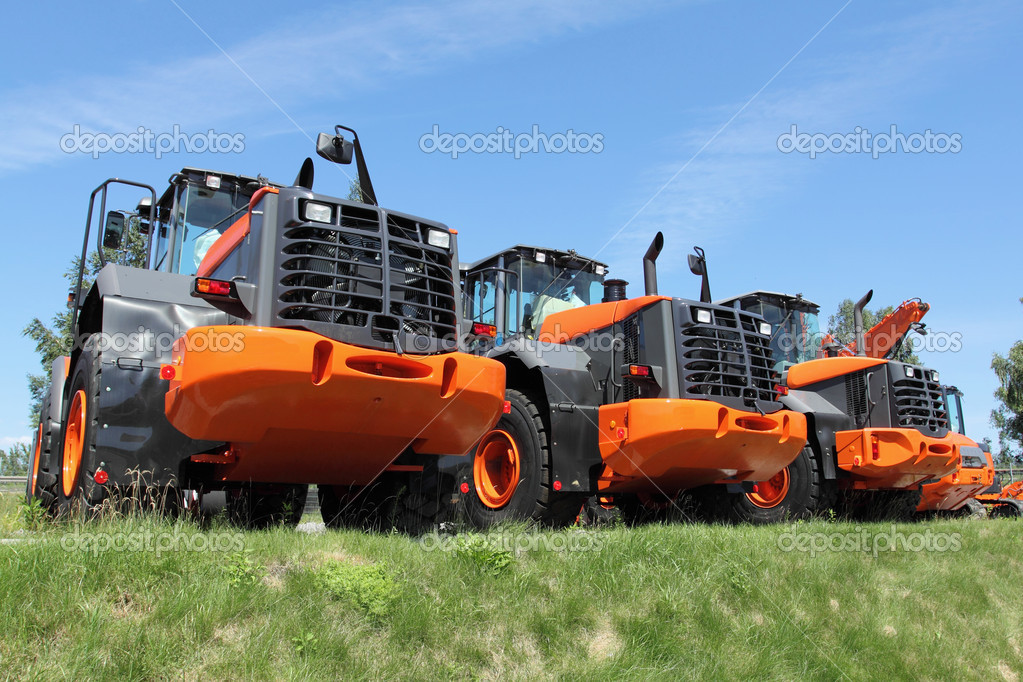 New, shiny and modern orange dozer machine. Construction industry machinery. — Stock Photo #13741156