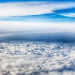 View of clouds from a airplane window. HDR image — Stock Photo