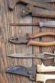 The old working tool against old wooden planks — Stock Photo
